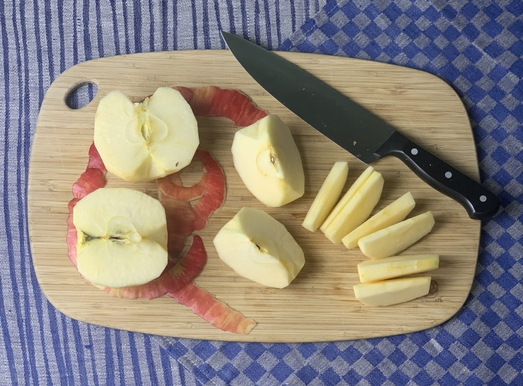 Apples cut into halves, then quarters, then cored and cut into eighths for vegan gluten free apple crisp